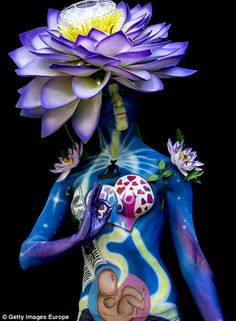 A model poses for a picture during the World Bodypainting Festival 2016 on July 2016 in Poertschach am Woerthersee, Austria. (Photo by Jan Hetfleisch/Getty Images) Body Painting Festival, World Bodypainting Festival, Body Art Photography, Belly Painting, Design Floral, Make Up Art, Illusion Art, Arte Pop, Art Of Living