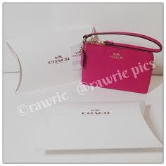 """New Coach pink leather wristlet with gift box 100% authentic. Crossgrain pink leather with gold tone hardware. Zip top closure and fabric lining. Strap with clip to form wrist strap or attach to inside of bag. Measures 6"""" x 4"""". Brand new with tags. Comes from a pet and smoke free home. Coach gift box included. Coach Bags Clutches & Wristlets"""