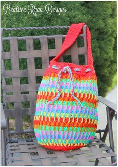 """If you were a fan of my Rainbow Dash Baby Blanket, you will love making this fun, bright Rainbow Dash Crochet Tote Bag!! Very repetitive stitching makes this tote bag easy to make and the texture makes it pop… Great as a Market Bag, Beach Bag or Project Bag too!! Another great feature is you can use up your scrap yarn stash and make it in many different color combos!!"""