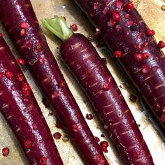 Pink peppercorns on purple carrots