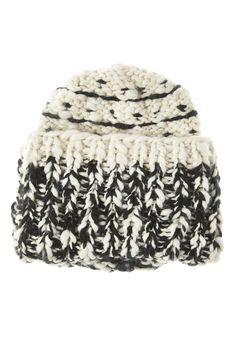 A chunky knit and slouchy silhouette define a cuffed beanie that's sure to keep you warm all winter long.   Limitless Cuffed Beanie by Free People. Accessories - Winter Accessories New Hampshire