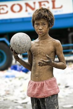 http://121clicks.com/showcases/disadvantaged-children-photography-by-thomas-tham