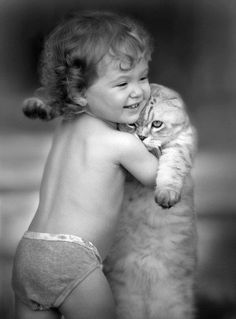 adorable baby lifting fat cat