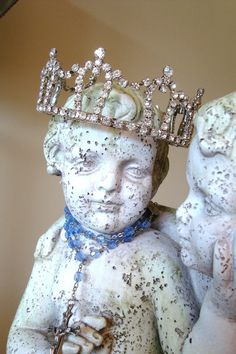twin cherub statue with crown and rosary