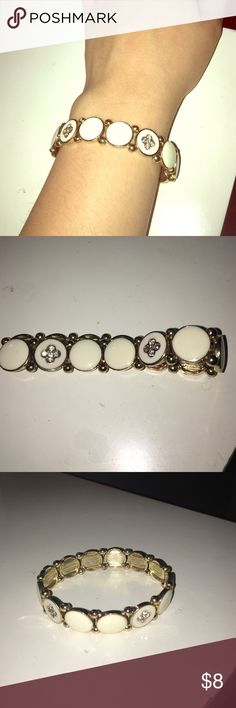 White and Gold Fashion Bracelet Adorable bracelet with rhinestone and gold embellishments. Very cute and great for layering! Jewelry Bracelets
