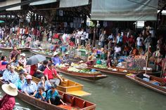 Floating market is the place for your tour in Thailand by paddle boat.