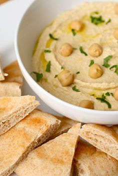 Roasted Garlic Hummus    Ingredients:  2 heads garlic, intact,  2 tbsp. olive oil,  2 cloves garlic, peeled and sliced,  3 tbsp. freshly squeezed lemon juice,  ¼ cup water,  6 tbsp. tahini,  1 (14 oz.) can chickpeas, drained and rinsed,  1 clove garlic, minced,  ½ tsp. salt,  Pinch of cayenne pepper,  1 tbsp. fresh parsley, minced