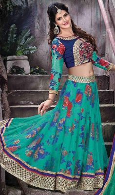 Look modish like Zarine Khan in this green and blue color velvet silk net lehenga cholie. This attire is well created with lace and resham work.  #traditionalwears #trendylooklehengas #partywearcholi
