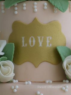 A closeup of my gold, love plaque.