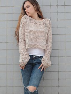 New design! Loose weaved wool sweater. It is made of high quality soft 60% wool/ 40% acrylic chunky yarn. Color: Wheat More new colors are coming. Size: S(0-4) M(6-10) L(12-14) Hand wash in cold water and lay flat to dry. Pls. check the sweater section for more options: http://www.etsy.com/shop/MaxMelody?section_id=7175104 Design rights belong to Maxmelody