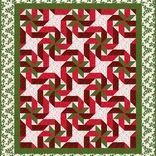 Pattern by Marjorie Rhine. Wrap up your bed with these ribbons & star-like bows ! This pattern has instructions to rotary cut and machine piece the Gift Wrapped quilt in three sizes. Place mat and table runner information also now included.  Gift Wrapped looks great in Christmas and other fabrics.