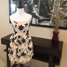 Ark & Co Navy and Cream Strapless Dress Ark & Co Navy and Cream Strapless Dress from ModCloth. Delicate, navy blue embroidered floral design on a cream, bubble tiered dress. Hidden side zipper, boning at the top back of dress for support, and Elasticized bottom of dress. Elastic strip at top of dress to help keep up if needed. Fully lined, 100% cotton, hand wash. Excellent condition. Worn once. ModCloth Dresses