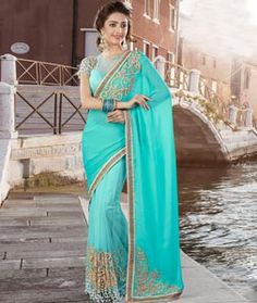 Buy Aqua Net Party Wear Saree 77902 with blouse online at lowest price from vast collection of sarees at Indianclothstore.com.