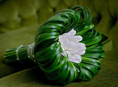 wedding bouquet using the greenery to create a cool design with white flower