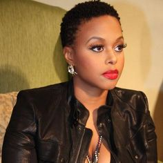 Chrisette Michelle has a lil bit o Janet and a whole lot o Fierce Natural Pixie going on. And hellyeah red lips on black girls!