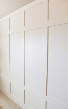 Simple board and batten DIY paneled wall tutorial! We didn't add any trim to our version so it's a little more modern for the boy's room. White Wall Paneling, White Walls, Wood Wall Paneling, Paneling Ideas, Paneled Walls, Wall Wood, Home Bedroom, Bedroom Decor, Bedroom Ideas