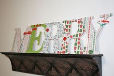 Instead of hanging the girls' name letters I am going to make from their walls with ribbons I think I will do them on a shelf similar to this. I think it looks more mature.still super cutesy but not so babyish as the ribbon letters Christmas Colors, Kids Christmas, Christmas Decorations, Christmas Patterns, Holiday Decorating, Merry Christmas, Paper Mache Letters, Wood Letters, Custom Woodworking