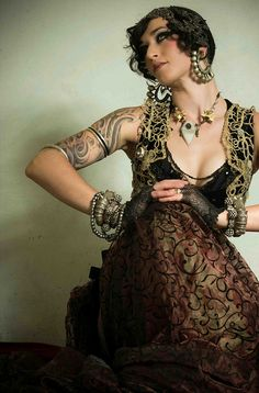 Beautifulest Gypsy. I love the outfit the jewelery her...everything here lol! I LIKE THE LOOK----FUN JEWELRY AND COOL SHRUG