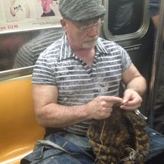 Just when I thought I had seen it all. Popeye knitting on the subway