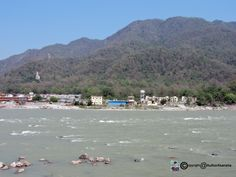 Rishikesh - Rishikesh is a city in Indias northern state of Uttarakhand in the Himalayan foothills beside the Ganges River. The river is considered holy and the city is renowned as a center for studying yoga and meditation. Temples and ashrams (centers for spiritual studies) line the eastern bank around Swarg Ashram a traffic-free alcohol-free and vegetarian enclave upstream from Rishikesh town.  #landscape #photo #image #photography #nature #travel #art #beinspired #sky #sunrise #sea…