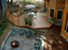 Multi-level deck transitioning to stone patio.