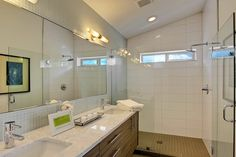 Bright and open master bathroom with large walk-in shower.