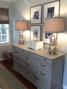 The Houston House small master bedroom solutions. Mercury glass lamps and gray dresser. Oversized mat frames, roman shade. Behr Dolphin Fin. Pottery Barn Mia Rug.