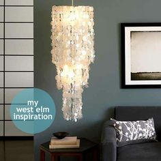 A diy capiz chandelier. This looks awesome and easy to do. Yes, I will try this one.