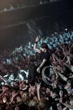 wheelchair surfing at a rock concert