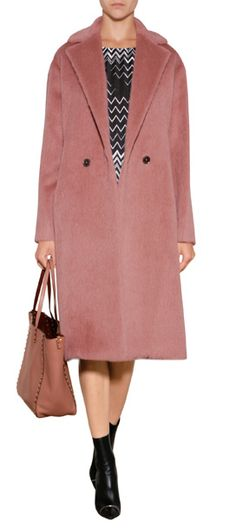 Rendered in a fuzzy mix of llama hair and wool, this textured coat from Salvatore Ferragamo is a stunning choice for autumn. An antique rose hue lends a feminine twist to this contemporary menswear-inspired silhouette #Stylebop