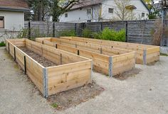 Garden beds with Wooden Frames ready for planting Raised flower beds. Garden beds with Wooden Frames ready for planting