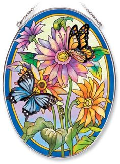 Amia Oval Suncatcher with Daisy and Butterfly Design, Hand Painted Glass, 6-1/2-Inch by 9-Inch by Amia. $24.00. Handpainted glass. Comes boxed, makes for a great gift. Includes chain. Amia glass is a top selling line of handpainted glass decor. Known for tying in rich colors and excellent designs, Amia has a full line of handpainted glass pieces to satisfy your decor needs. Items in the line range from suncatchers, window decor panels, vases, votives and much more.