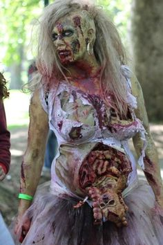 This actually isn't a list of the 15 best pregnant zombie costumes. This is a list of the 14 best pregnant zombie costumes, and one fat dude with a weird baby growing out of… Horror Makeup, Zombie Makeup, Scary Makeup, Sfx Makeup, Asylum Halloween, Halloween Kostüm, Holidays Halloween, Pregnant Halloween Costumes, Creative Halloween Costumes