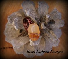 """""""SOLD""""  Earth Escapes ( two tone agate ring)   Faceted oval two tone agate gemsotne and artisitic wire.   This designs was published in Bead Trends Magazine March Issue.   Ring Size 7. https://www.etsy.com/shop/BeadFashionDesigns"""