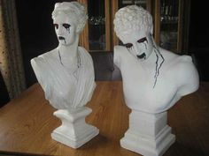 Statues turn demonic with a bit of black ooze and red eyes.