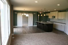 """Beautiful living space in """"The Taylor""""! The barn doors make it that much better <3"""