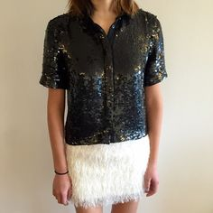 """[topshop] black sequin button-down top Although stunningly glamorous with all the sequins, this button-down top is also v practical. Wear it unbuttoned with a graphic t underneath for a casual look. Or dress it up by buttoning it up all the way and pairing with a neoprene skirt and ankle booties. very versatile! the only flaw is on the back (left shoulder, pic #3), there are some sequins missing. V unnoticeable, however. Minus that, excellent condition. 19"""" shoulder to hem; 17"""" pit to pit…"""