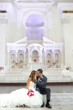 The couple snap a few first look photos on the impressive white marble stage. Wedding Floral and Event Design: Posh Peony Floral and Event Design.