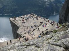 Preikestolen aka Pulpit Rock in Lysefjorden, Norway. 604 meters down to the fjord. An hour's walk each way if you're light-footed. July 27th 2015