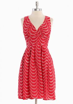 A dose of bright red is just right, anytime.  I love how this dress hugs the waist, it accents your curves!