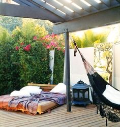Hammock, wall art, bed, and they grey perogola sets if off for me.