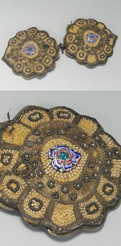 Turkey | Ottoman belt buckle; silver with silver-gilt thread, seed pearl and enamel applique decoration, the two elements of lobed drop-shaped form | ca. 18th century | Est. 3'000 - 4'000£ ~ (Oct '04)