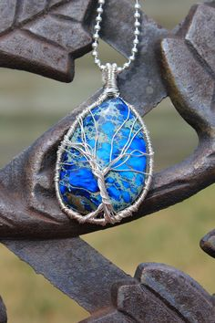 Silver  Wrapped Tree of Life Tree Sculpture on a Blue Jasper Cabochon, fashion for Man, Women and Teen. $29.95, via Etsy.