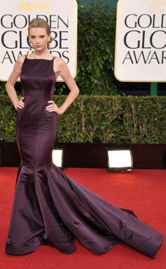 Taylor Swift exudes elegance in a purple Donna Karan Atelier gown with a dramatic mermaid tail at the 2013 Golden Globes. http://tumblr.hollywoodjunket.com/post/40535539297/taylor-swift-golden-globes-1-14-13 #Celebrities #GoldenGlobes