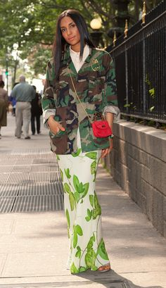 Here I am in Bryant Park—I like to pick up a coffee on the way in to work—wearing camouflage, one of my all-time favorite prints. I have enough military surplus in my closet to outfit a small army. Years ago, I went to a friend's wedding in Barbados and was horrified to find out that wearing fatigues is banned for civilians there! Needless to say, I had to do a major edit of my suitcase to get through customs.I like to think of the print on this Diane von Furstenberg skirt as a more delicate…