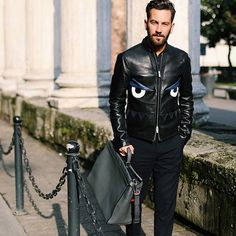 Matthew Zorpas in a black graphic leather jacket during MFW