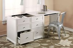Oxford Hidden Desk - I just got this desk in black and love it!! The desk top rolls in and out so you can't tell its a desk when not in use, perfect for a desk in the the family room. $359