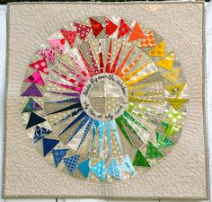 Over The Rainbow mini: circle of flying geese + New York Beauty + incredible quilting. And you have to see the back!