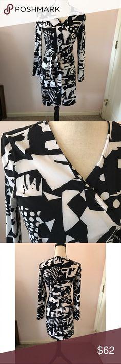Beautiful Armani Exchange dress Gorgeous geometric design! Material is 85%poly, 15% spandex. Armani Exchange Dresses Midi