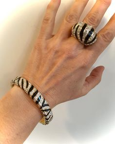Gorgeous Domed Design On This Zebra Inspired Piece Features Glossy Black Enamel Zebra Stripes with Ultra Shimmery Pave Two Tone Plating Highlights The Beautiful Detail  Would Pair Nicely with Many Items In My Shop, Some previewed Here in The Photos, Please have a look through the various sections!  Zebra and Pave Ring Size 6.75 Ring Measures approx 3/4H Enamel and Crystal  Thanks For Shopping!  Enter My Shop Here For Lots More Vintage and Handmade Goodies: https://www.etsy.com...